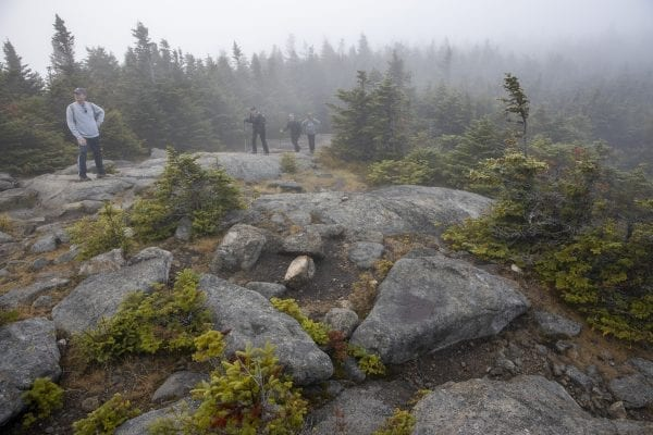 Hikers near the summit on Cascade Mountain on Sunday, September 29, on a cloudy day. Photo by Mike Lynch