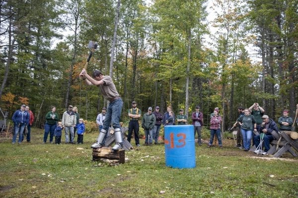 A Paul Smith's College student chops wood during the Adirondack Rural Skills and Homesteading Festival at the Paul Smith's College VIC. Photo by Mike Lynch