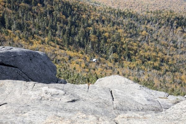 A drone flies over the summit of Cascade Mountain on Sunday, September 29. It is illegal to launch drones in wilderness areas in the Adirondack Park. Cascade is located in the High Peaks Wilderness. Photo by Mike Lynch