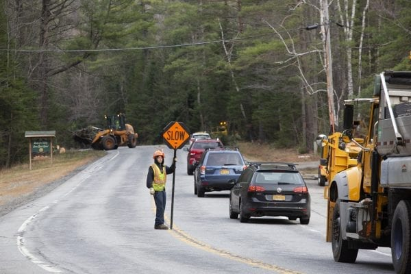 A road crew removes downed trees on Route 73 between the Northway and Keene Valley on November 5. Photo by Mike Lynch