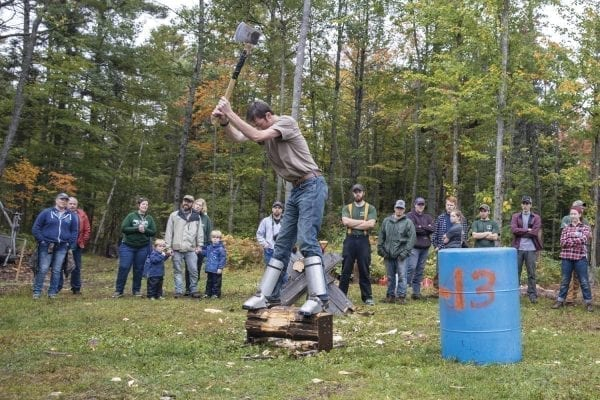 A Paul Smith's College student chops wood during the Rural Skills and Homesteading Festival at the PSC VIC in September. Photo by Mike Lynch