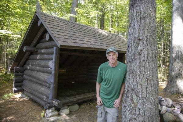 Sam Eddy poses in front of the Sand Lake lean-to. Photo by Mike Lynch