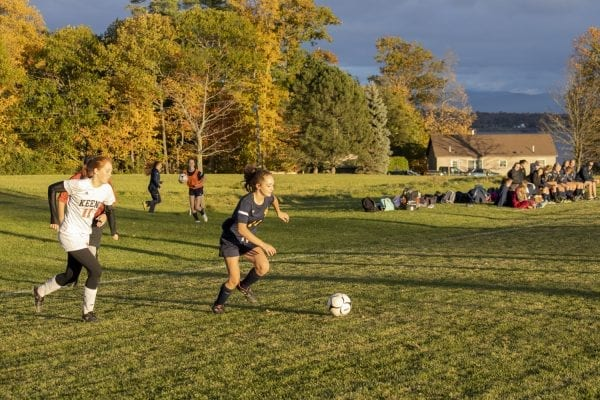 Students from Elizabethtown, Lewis and Westport all attend the same high school and play on the same girls soccer team. The school is an example of how small districts are merging in rural areas. Photo by Mike Lynch