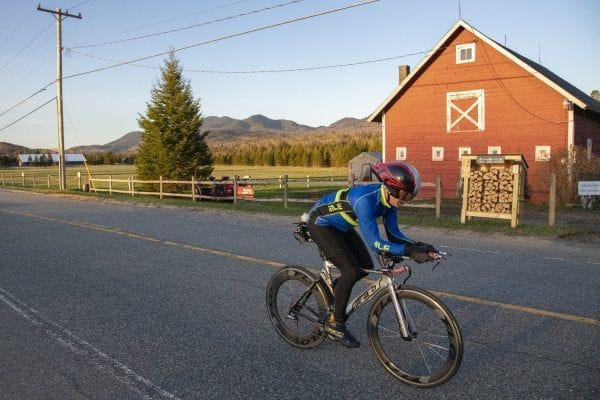 Eric Kreckel, who has multiple sclerosis, trains in early May in Lake Placid for the upcoming Ironman. The competition consists of a 2.4-mile swim, 112-mile bike ride and a 26.2-mile run. Photo by Mike Lynch