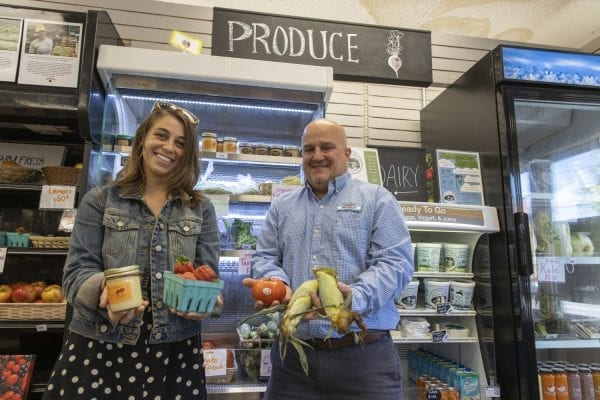 The Keeseville Pharmacy has filled a unique niche in its community by selling local food in addition to its normal products. Here, owner Dan Bosley, right, poses with ADK Action Farmacy Project Coordinator Kiana French in June. Photo by Mike Lynch