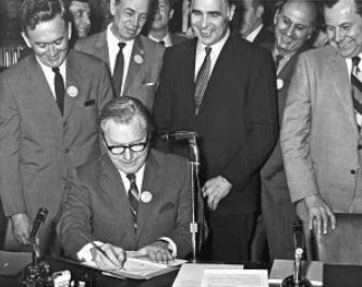 Nelson Rockefeller signing legislation.