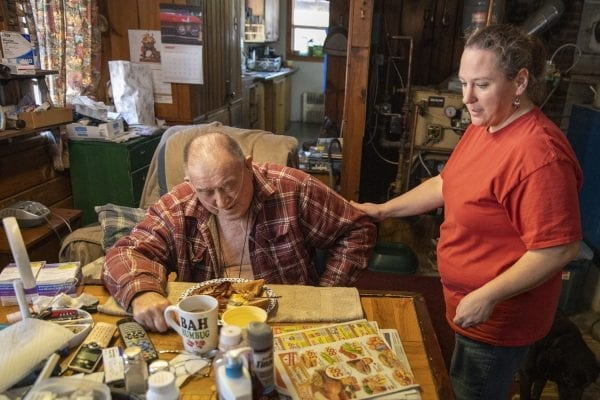 Home health aide Lisia Colegrove serves breakfast to client Thomas Wells. This image appeared in the January issue with a story about a need for home healthcare in the Adirondacks. Photo by Mike Lynch