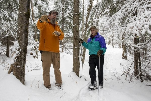 John Gillis talks to Jim Frenette on one of the trails being developed. Photo by Mike Lynch