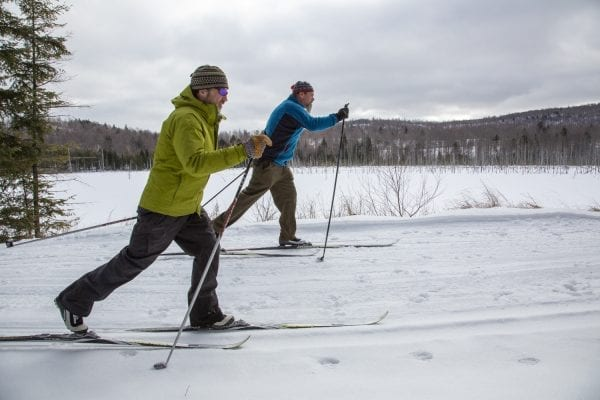 John Gills, back, and Eric Lanthier ski the James Frenette Trails in Tupper Lake. Photo by Mike Lynch