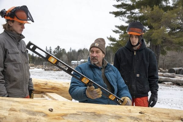 Bob Liseno teaches local students how to build a lean-to. Photo by Mike Lynch