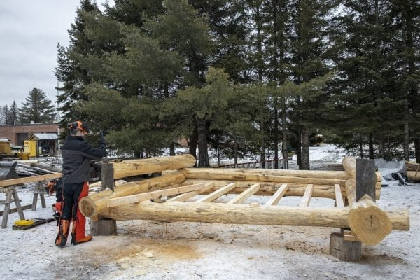 Bob Liseno is featured in the Trailblazer column of the March issue of the Explorer for his work with students in the BOCES program taught at the Adirondack Educational Center in Saranac Lake.  Here, Liseno teaches the students to build a lean-to on a cold January day. Photo by Mike Lynch