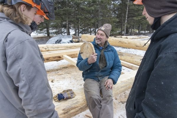 Bob Lisend teaches local students how to build a lean-to. Photo by Mike Lynch