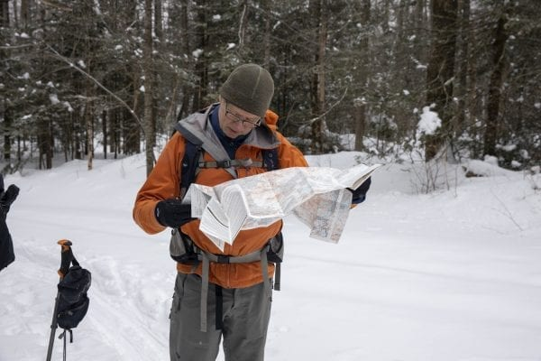 Phil Brown looks at a map on the way to Hurricane Mountain. Photo by Mike Lynch