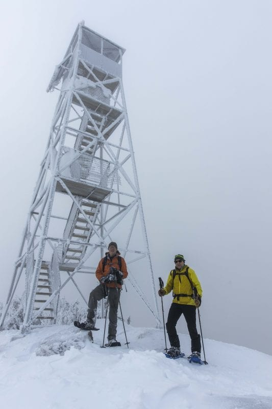 Phil Brown, left, and Tim Peartree summited Hurricane Mountain on February 11, 2020, skiing the lower elevations and snowshoeing the steeper upper section of the trail. They used the Hurricane Mountain Lane trailhead in Elizabethtown. Photo by Mike Lynch