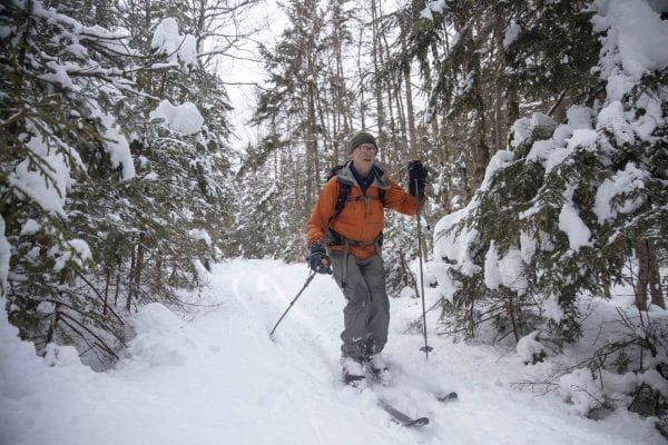 Phil Brown, shown here, and Tim Peartree summited Hurricane Mountain on February 11, 2020, skiing the lower elevations and snowshoeing the steeper upper section of the trail. They used the Hurricane Mountain Lane trailhead in Elizabethtown. Photo by Mike Lynch