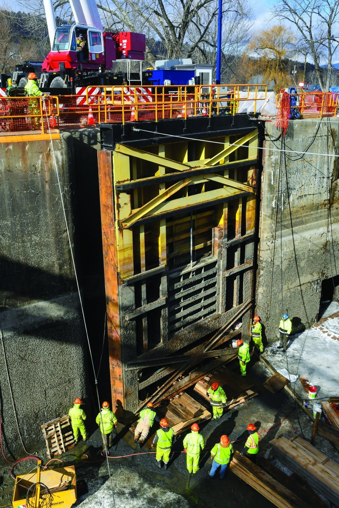 Canal employees work to level a miter gate on Lock 12 in the Champlain Canal. Photo by Cindy Schultz