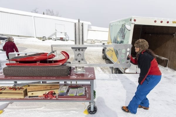 U.S. Luge official Peggy Mousaw, a volunteer, checks a sled during a competition in late February at Mount Van Hoevenberg. Mousaw will be featured in the Trailblazer column in the May issue of the Explorer. Photo by Mike Lynch