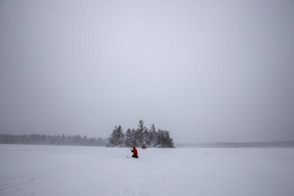 Ice fishing can be a solitary experience. Photo by Mike Lynch