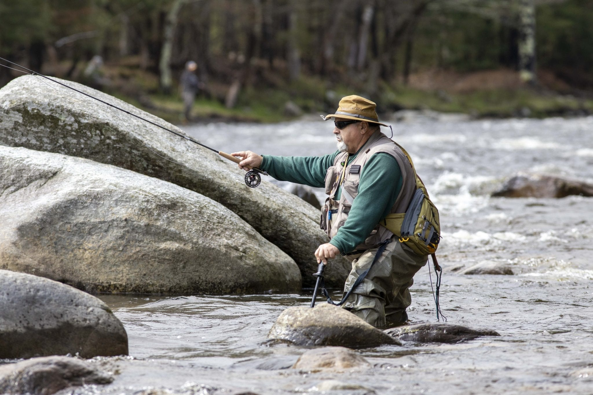 A man fishes in the Two-Fly Challenge on the West Branch of the Ausable River
