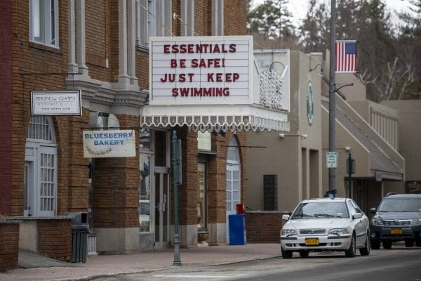 The Palace Theater in downtown Lake Placid has repurposed its sign out front this year to display messages to the public, which range from humorous to encouraging. Photo by Mike Lynch