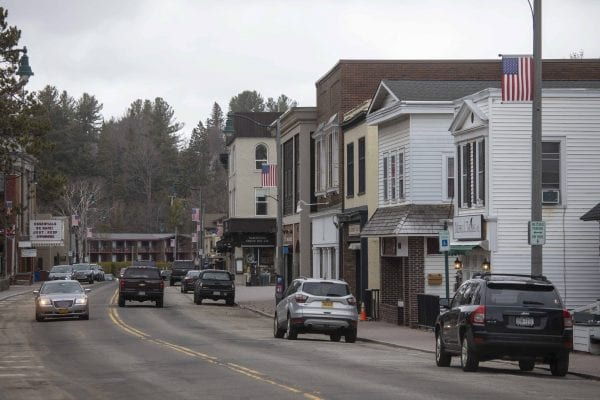 Downtown Lake Placid is  quiet on this late April day, but traffic still makes its way through town. Photo by Mike Lynch