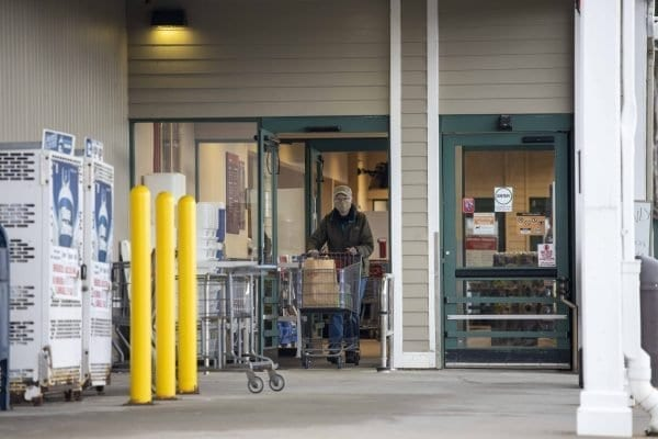 A shopper leaves Hannaford in Lake Placid. Masks are now required in places where social distancing is not possible. Photo by Mike Lynch