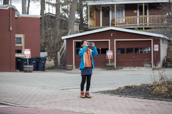 A woman stops for a photo of the Olympic facilities in Lake Placid. Photo by Mike Lynch