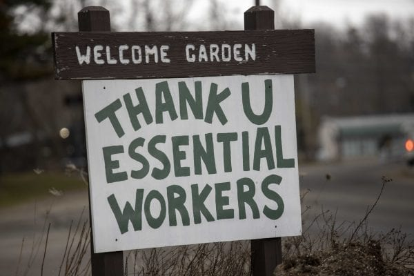 Signs like this one in Saranac Lake have been popping up throughout the Adirondacks. Photo by Mike Lynch