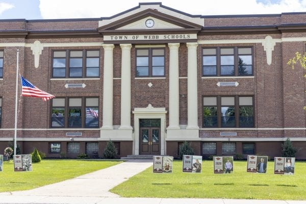 The high school in Old Forge is honoring students by having their photos out front. Photo by Mike Lynch