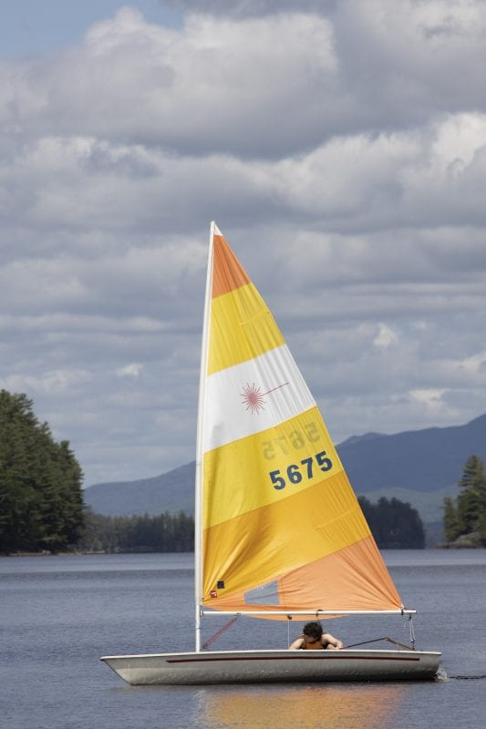A man sails on Long Lake in late May. Photo by Mike Lynch