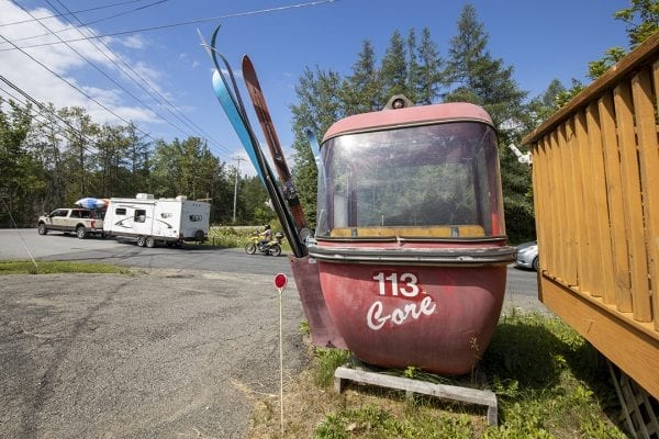 Question: This old gondola sits alongside an entrance road to a state campground. What town is the campground and old ski relic located in? Answer: Town of Newcomb. You can see it when you are driving to Lake Harris State Campground.