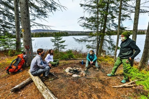 Betsy Kepes, husband Tom Vandewater, and young friends Amanda Oldacre and Jim Burdick hiked and backpacked the Cranberry 50 in the spring for an article Kepes wrote for the July issue. Photo by Nancie Battaglia