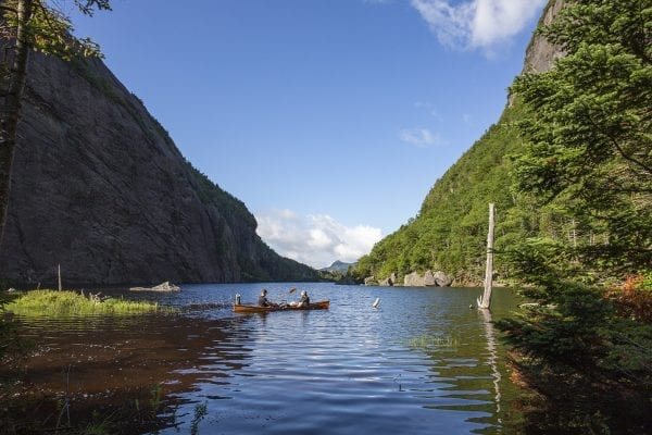 Question: What is the name of this popular high elevation lake?  Answer: Avalanche Lake, which is located in the High Peaks Wilderness.