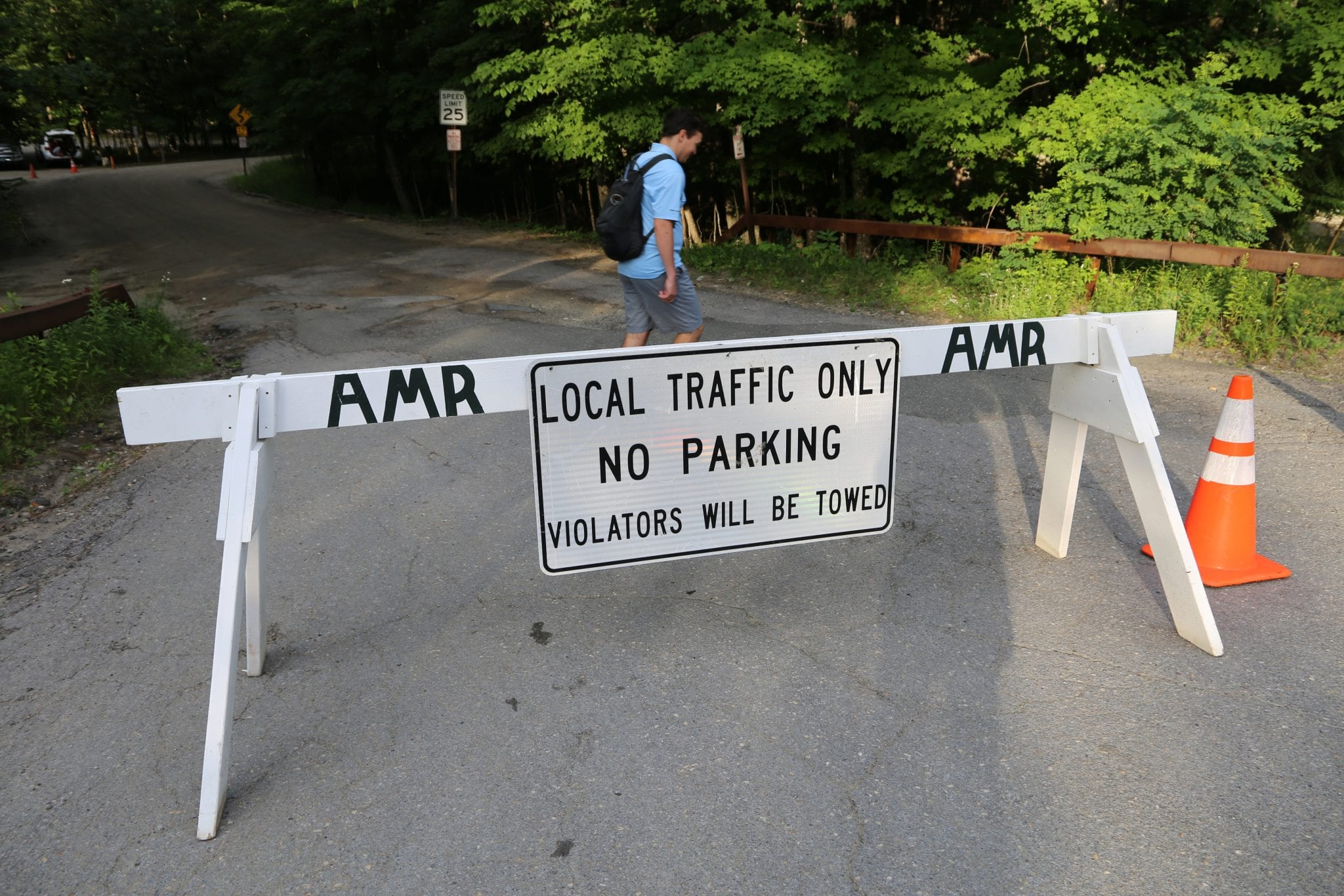 A photo of a barrier at Adirondack Mountain Reserve's parking lot for hikers.