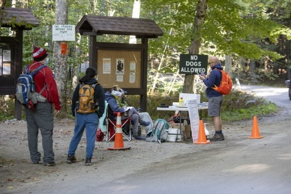 Hikers partake in a survey being conducted about usage. Photo by Mike Lynch