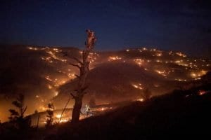 New York firefighters pitch in as West burns
