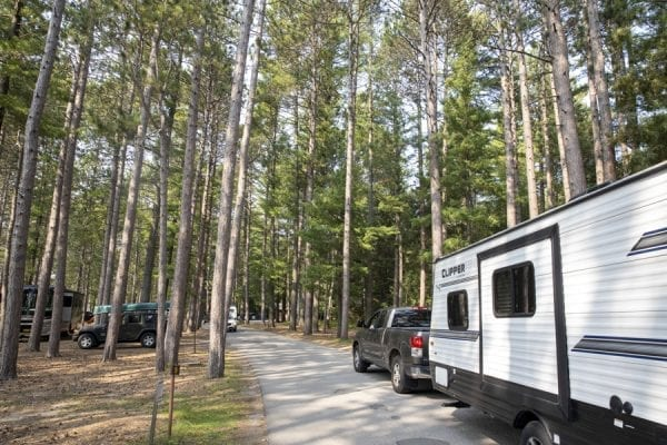A camper drives down the main road at the Fish Creek Campground. Photo by Mike Lynch