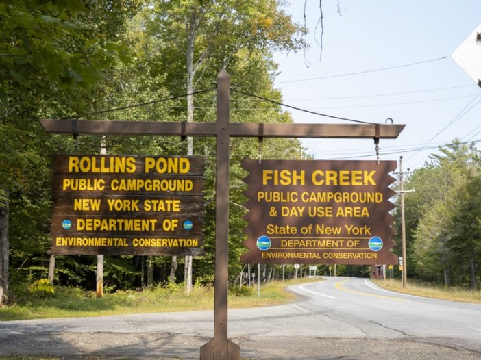 fish creek and rollins pond signs