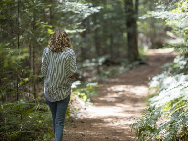 Explorer intern Francesca Krempa walks along the trail during an exercise. Photo by Mike Lynch