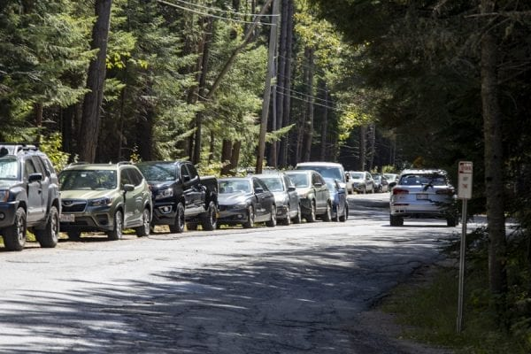 A crowded day on Adirondack Loj Road in Lake Placid. These vehicles were parked by hikers heading into the High Peaks. Photo by Mike Lynch