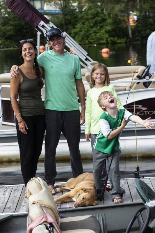 The Hesseltine family, from left, Becky, Jake, Nina, 9, Mason 7, and their dog Tanny travel from California to fish at Lake Flower in the village of Saranac Lake. Photo by Benjamin Chambers