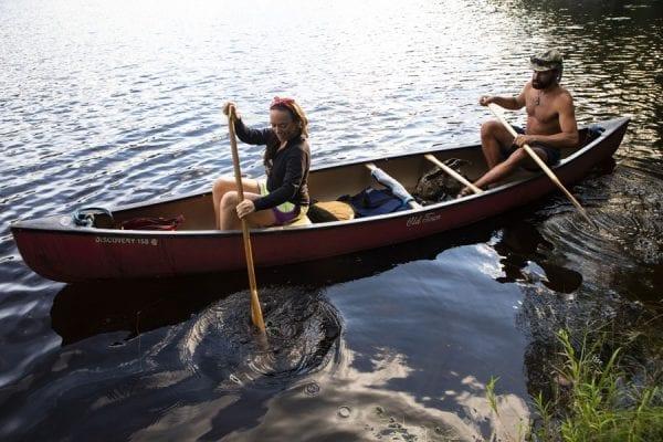 Cat Boland, 33, and Cooper Lambla, 32, both from North Carolina, paddle in the Saranac River near Frankin Falls. Photo by Benjamin Chambers
