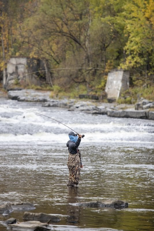 Caleb Hill fishes on the Boquet River. Photo by Mike Lynch