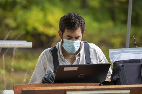 Jonah Withers, of the U.S. Fish and Wildlife Service, enters data in the field. Photo by Mike Lynch