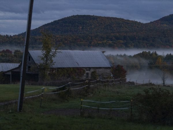 Fog settles around a farm in the Champlain Valley. Photo by Mike Lynch