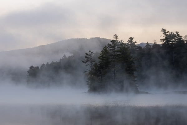 Morning fog on Franklin Falls Pond in September. Photo by Mike Lynch