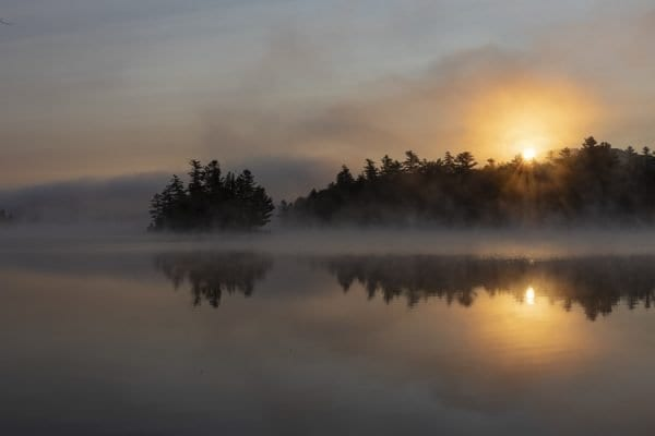 Sunrise on Franklin Falls Pond in September. Photo by Mike Lynch