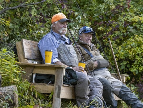 Anglers wait their turn on a bench in an area known as the Conference Room. Photo by Mike Lynch