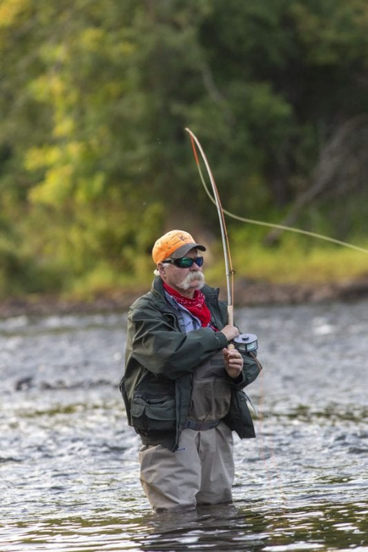 Rich Redman casts for a salmon. Photo by Mike Lynch