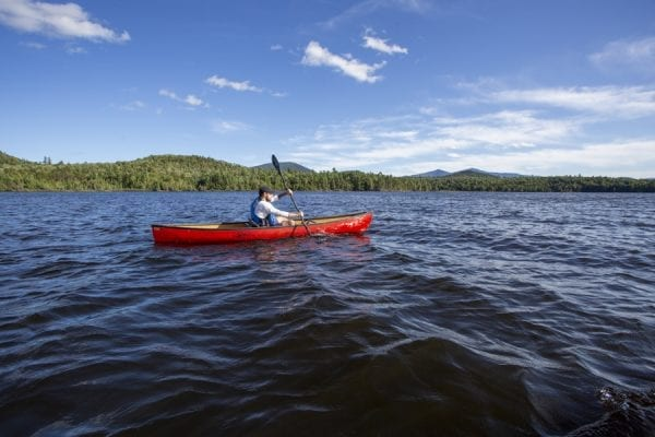 Chris Morris paddles Union Falls Pond on the Saranac River. Photo by Mike Lynch
